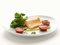 Steamed salmon fillet with corn salad and tomatoes - stock photo