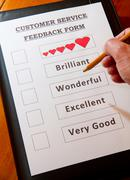 Funny Customer Service Feedback Form with options for rating service - stock photo