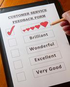 Customer Service Feedback Form with options for rating service including `love` - stock photo