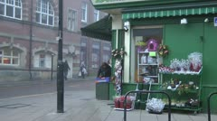 Green Grocers at Christmas, wreaths on display outside corner shop Stock Footage