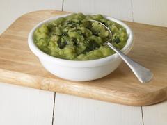 Mushy peas with mint sauce - stock photo