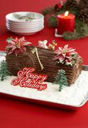 Chocolate Yule Log with Happy Holidays Sign - stock photo