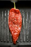 Red pepper in a grill frying pan - stock photo