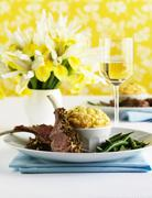 Lamb chops with cheese soufflé and beans - stock photo