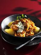 Szeged turkey goulash on potatoes - stock photo