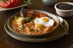 Chupe de Camarones (Shrimp Stew, Peru) with Fried Egg Stock Photos