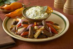 Lamo saltado (Beef with peppers and onions, Peru) Stock Photos