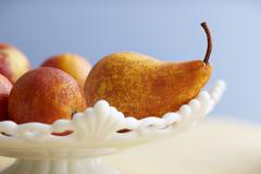 Pears and Blood Oranges on Cake Stand Stock Photos