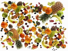 Many different types of fruit against white background - stock photo