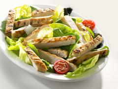Salad with strips of chicken breast Stock Photos