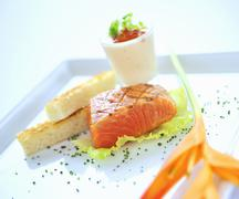 Lightly fried, marinated salmon with white bread - stock photo