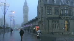 Market place in fog with Christmas lights and clock tower Stock Footage