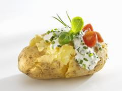Baked potato with quark and chives - stock photo