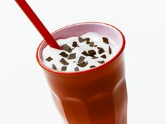 Milkshake with flakes of chocolate Stock Photos