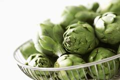 Fresh Artichokes in a Metal Basket - stock photo