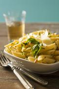 Penne Pasta with Basil and Parmesan Cheese Stock Photos