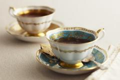Elegant English Tea Cups and Saucers - stock photo