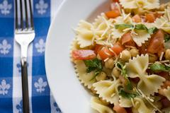 Bowl of Pasta Salad with Chickpeas, Tomatoes and Fresh Herbs - stock photo