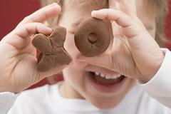 Little boy holding XO biscuits - stock photo