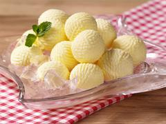 Butter balls on ice Stock Photos