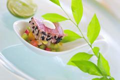 Tuna on mango and papaya salad Stock Photos