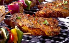 Pork steaks on barbecue Stock Photos