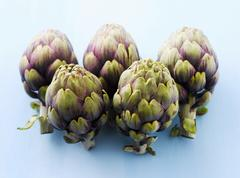 Five artichokes - stock photo