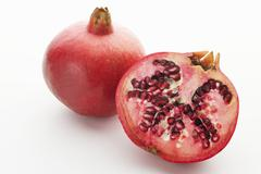 Whole pomegranate and half a pomegranate Stock Photos