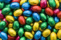 Chocolate eggs in coloured foil Stock Photos