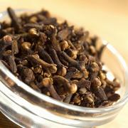 Cloves in glass dish (close-up) Stock Photos
