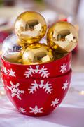 Gold Christmas baubles in two bowls Stock Photos