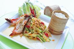 Grilled prawns with papaya salad and rice - stock photo