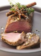 Loin of venison with herbs and spices Stock Photos