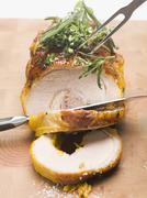 Stuffed breast of veal, partially carved - stock photo