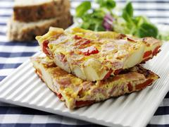 Ham and vegetable omelette Stock Photos
