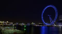 Time lapse of River Thames and London Eye at night Stock Footage