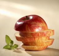 Apple slices, stacked to form an apple, fresh mint Stock Photos