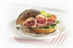 Salami in poppy seed roll Stock Photos