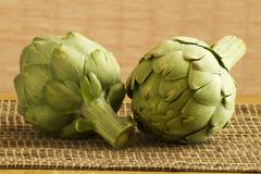 Two Whole Artichokes - stock photo