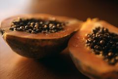 Halved Papaya - stock photo