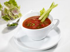 Tomato soup with celery sticks - stock photo
