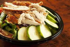 Fried Chicken Salad in Take Out Container - stock photo