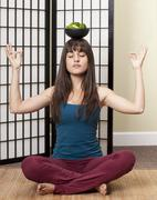 Girl in Yoga Pose Balancing a Bowl of Broccoli on her Head Stock Photos