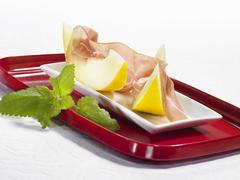 Parma ham with honeydew melon - stock photo