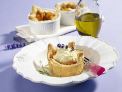 Vanilla ice cream with apricots and lavender in puff pastry dishes Stock Photos
