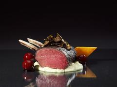 Venison with gingerbread sauce and candided cherries Stock Photos