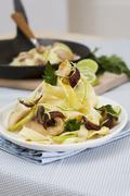 Tagliatelle with carp and lime curry - stock photo