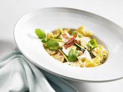 Pasta with prosciutto, champignons and Parmesan Stock Photos