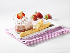 Sweet asparagus in beer batter and strawberry mascarpone cream Stock Photos