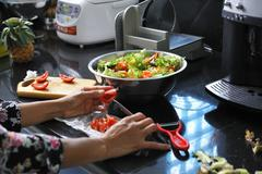 Salad being prepared - stock photo